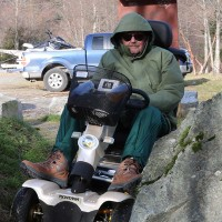 The gap between the boulder and the bank at the north end of the Chelem Trail is too narrow for this scooter to pass.